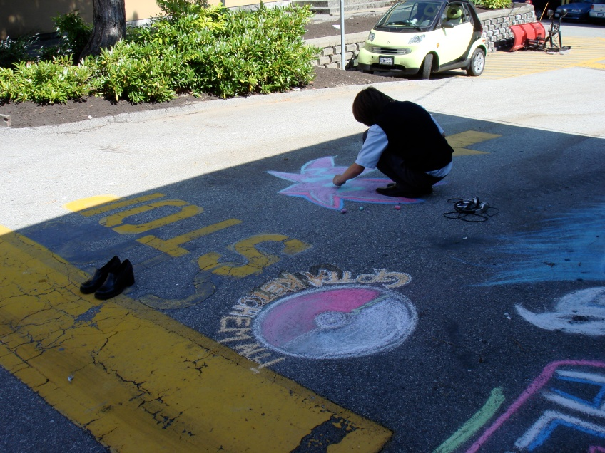 Student Chalking Road 5. Vancouver, Canada