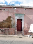 Red Door in Pink Wall. Oaxaca