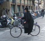 Woman on Bicycle. Rome, Italy