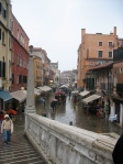 Canal Bridge Approach and Street in Rain. Venice, Italy